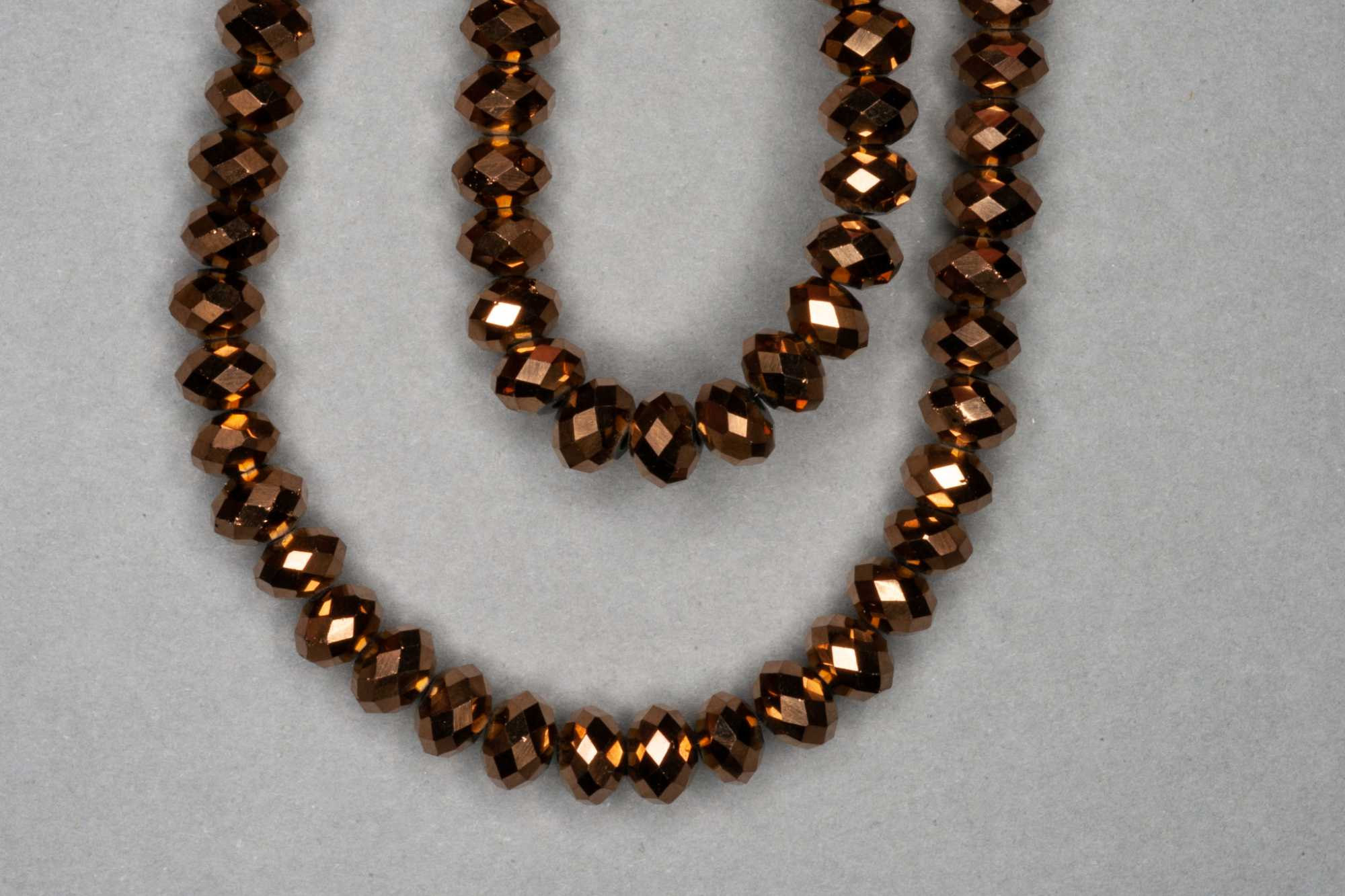 Metallic Bronze Faceted Glass Beads