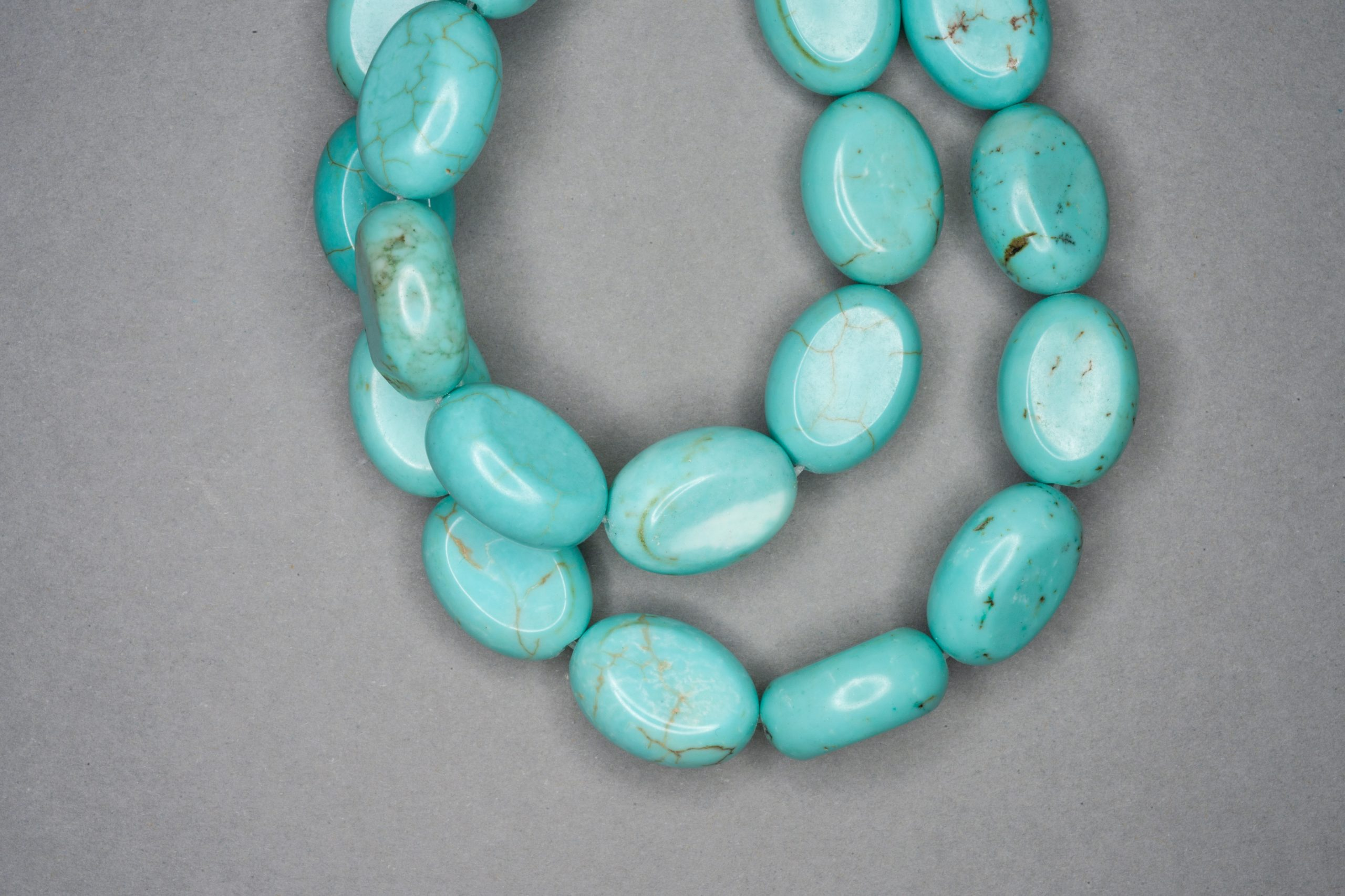 Chalk Turquoise 38cm Strand, 18x12x8mm Flat Oval