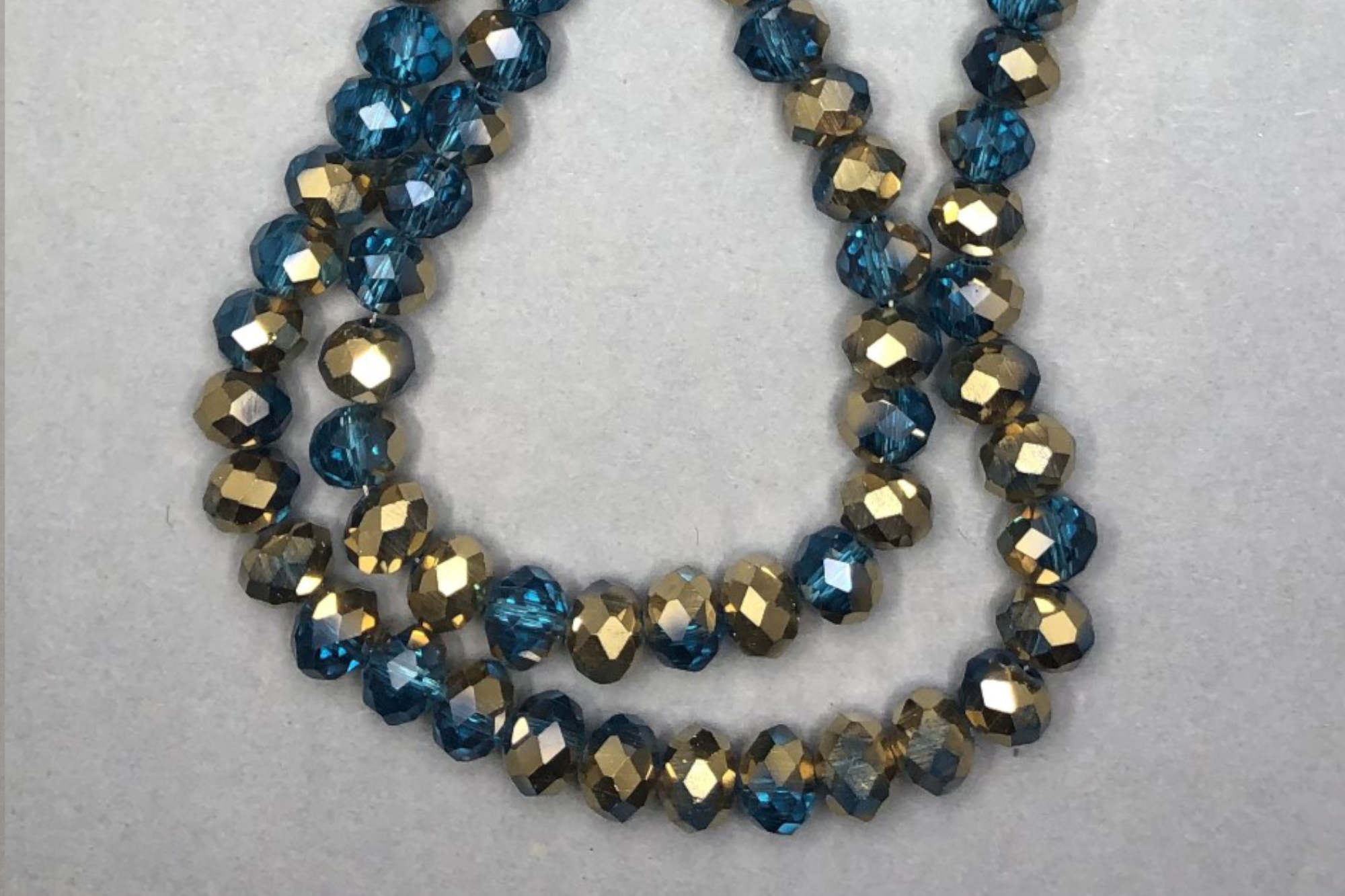 Half Teal/Bronze Faceted Glass Beads